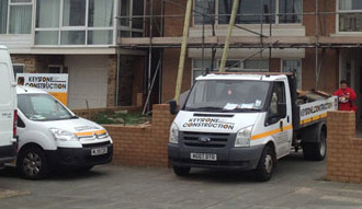 Image of two Keystone Construction North West Limited vans working on a job