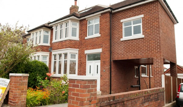 red bricked semi detached house with extension on the right hand side
