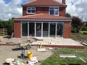 A picture showing the back of a Lytham property where a refurbishment and extension is in progress, indicated by the builder tools in the garden