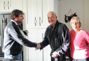 A picture showing a couple shaking hands with their Blackpool builder, their faces displaying great satisfaction with their full house renovation