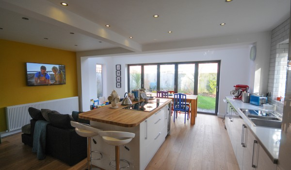 A picture showing a Blackpool communal living extension with a sleek and modern kitchen and sitting area