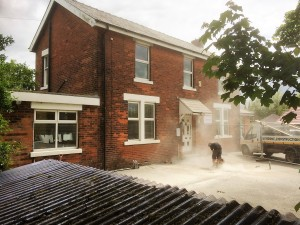 An image showing builders Blackpool working on a new driveway on a home